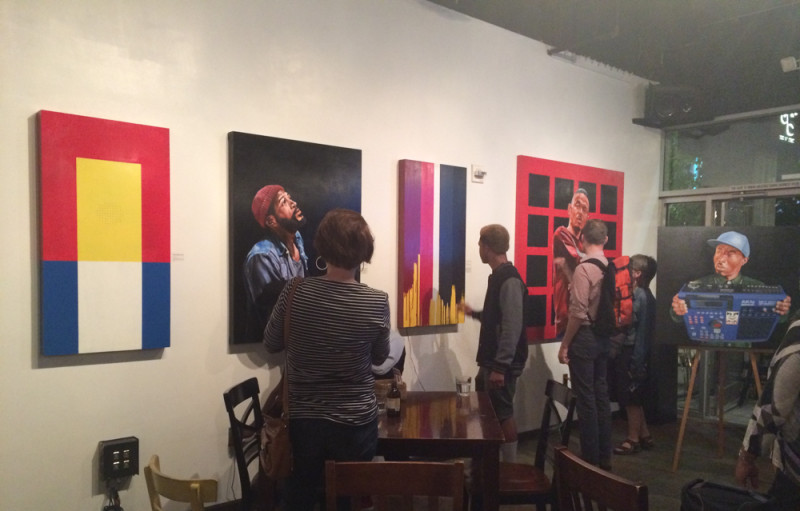 Guests interacting with Detour's paintings
