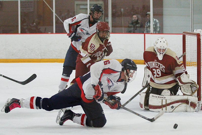Bobby Valdez (6) falls as he attempts a shot on DU goalie Geoffrey Dohrmann(39) while Doug Kurzawski (15) and Cesar Soto (11) battle in front of the net. The Roadrunners beat the Pioneers 6-4 at The Edge Ice Arena in Littleton on Friday, Oct. 16. Photo by Tom Skelley • tskelly@msudenver.edu
