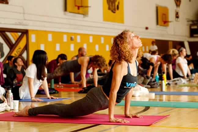 -SAN FRANCISCO, CA- Yoga enthusiasts practice yoga as part of RISE Yogathon fundraiser at Mission High School on Saturday March 19, 2016. Photo by Heather Pastorius/ hpastori@msudenver.edu