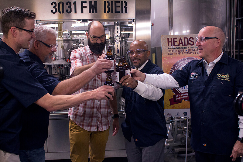 Members of the MSU Denver Brewing Industry program, owner of Tivoli Brewery Corey Marshall, and Mayor Michael B. Hancock provide a toast to kick off the 4th annual Denver Beer Fest Sept. 29 morning at the Tivoli. Photo by Esteban Fernandez • Eferna14@msudenver.edu