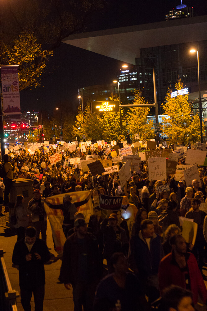 Thusday, November 10th, Downtown Denver CO. Protestors march down Speer Blvd just south of the Convention Center